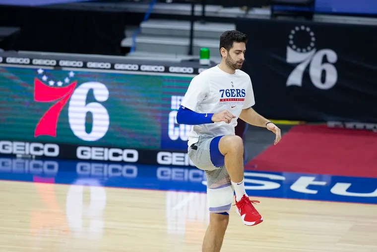 Furkan Korkmaz stretching before the team played the Heat at the Wells Fargo Center on Tuesday.