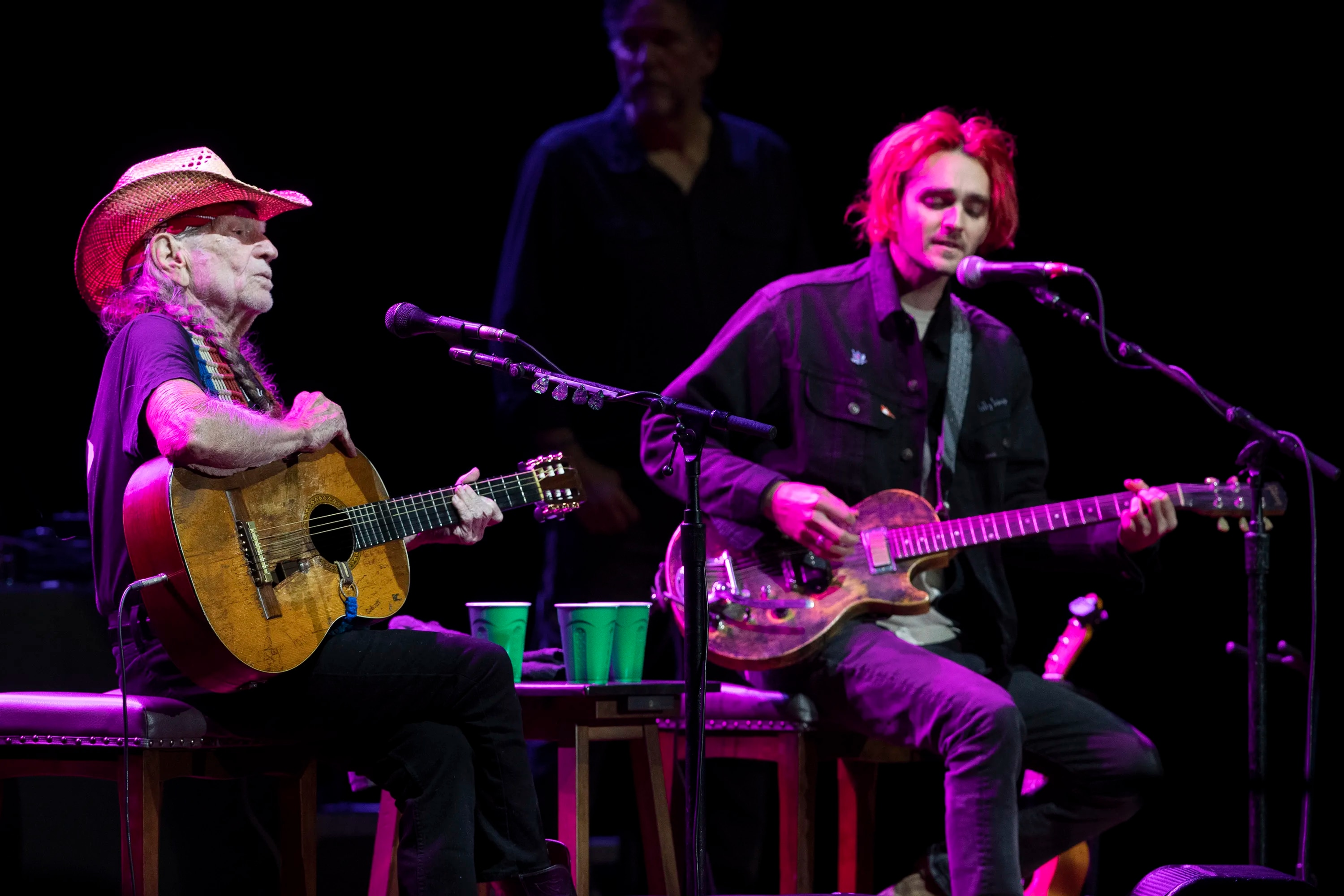 Willie Nelson and son Micah Nelson perform a duet at the Outlaw Music Festival at the Mann Music Center Saturday.