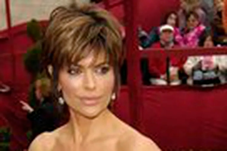Lisa Rinna, shown at the Academy Awards in February, is reportedly posing nude for Playboy.