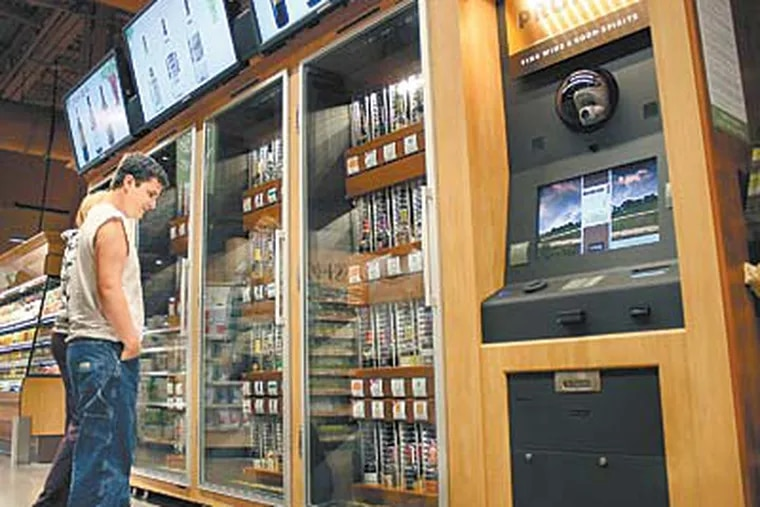 Jim Seibert and Kortney Zerphy at the wine selection at a Wegmans. A letter from the company to the LCB complained that the machines often malfunctioned. (Evan Trowbridge / Staff)