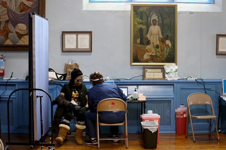 Swanie Goldsmith receives her COVID-19 vaccine at the Main Line Health vaccination clinic inside the African Episcopal Church of St. Thomas in Philadelphia on Feb. 10, 2021.