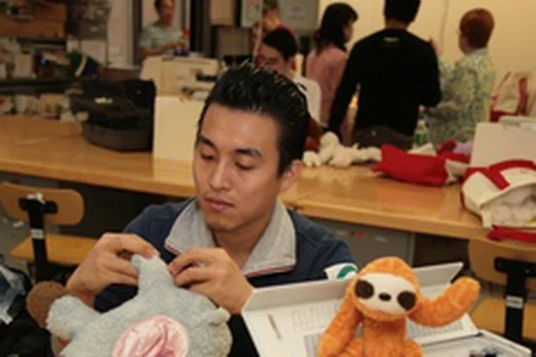 Sang Yoo Kwon works on a doll in Soft Toy and Doll Design class at Fashion Institute of Technology. Toy-design majors learn all about the industry, from manufacturing to business practices.
