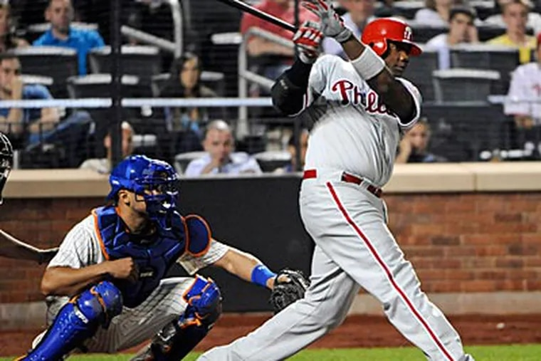 Ryan Howard hit a two-run double to give the Phillies the lead in the eighth inning. (Bill Kostroun/AP Photo)