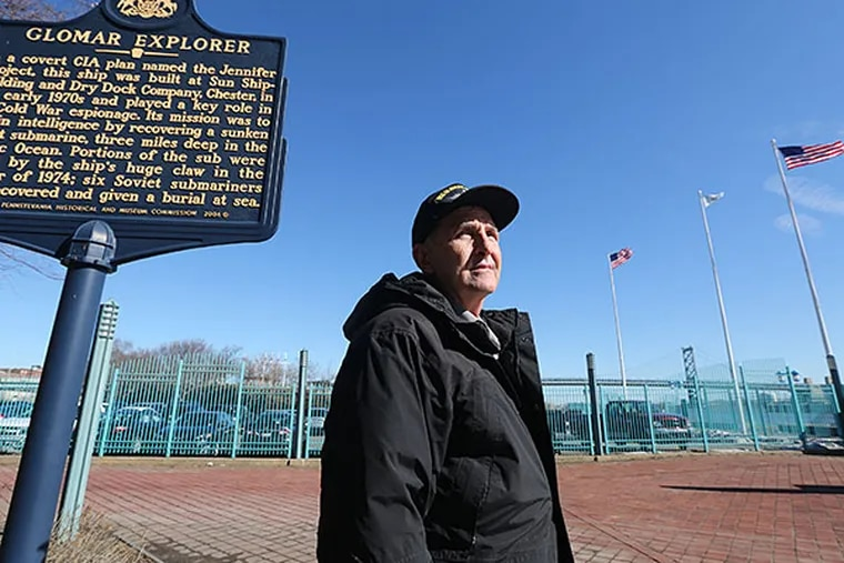 John Lahm with the Glomar Explorer marker at Penn's Landing. He wants to bring the spy ship to the waterfront, near where it was built in Chester. DAVID SWANSON / Staff Photographer