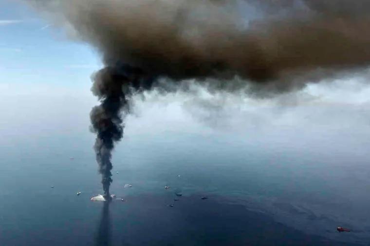 The Deepwater Horizon rig burning in April. BP's stock has risen 63 percent from its June low.