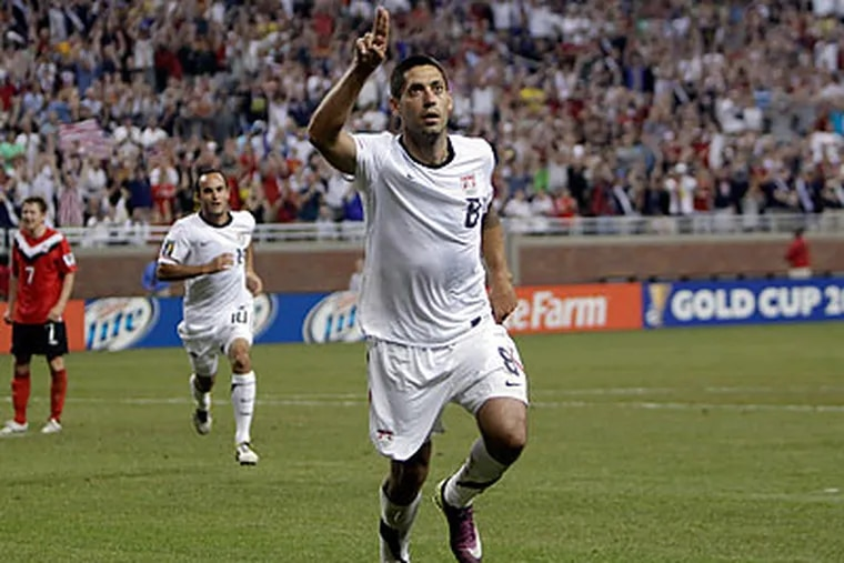 Clint Dempsey celebrates after scoring in the 62nd minute against Canada. (Paul Sancya/AP)
