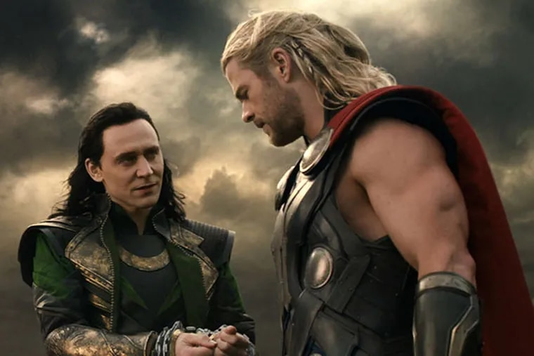 """This publicity photo released by Walt Disney Studios and Marvel shows Tom Hiddleston, left, and Chris Hemsworth in a scene from """"Thor: The Dark World."""" (AP Photo/Walt Disney Studios/Marvel)"""