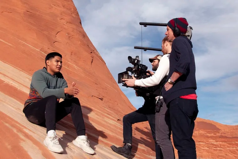 """Matt Howley (far right), director of """"Basketball or Nothing,"""" interviews Chine High School senior Darren Woody (seated) with help from cinematographers from The Workshop, which created the Emmy-nominated documentary series."""