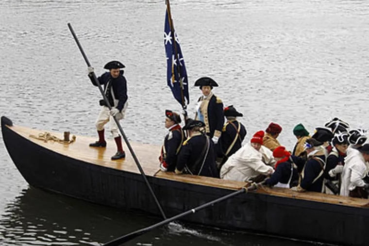 Gen. George Washington, in the person of John Godzieba, stands in a boat during yesterday's reenactment of the daring stroke of Dec. 25, 1776. (MATT SLOCUM / Associated Press)
