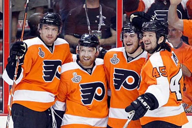 James van Riemsdyk (far left) assisted Matt Carle's goal in the Flyers' Game 4 victory last night. (Yong Kim / Staff Photographer)