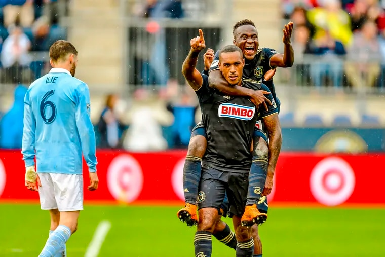 Jay Simpson (center) celebrates with David Accam after scoring the first of his two goals for the Philadephia Union against Sporting Kansas City.