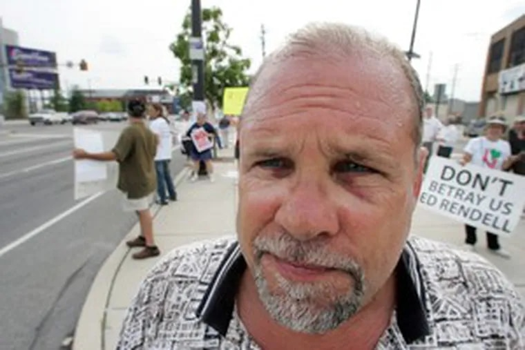 Ed Verrall, an anti-casino activist, says he was punched in the nose and injured during a fight with Fishtown neighbors who are supporting the development of the SugarHouse casino.