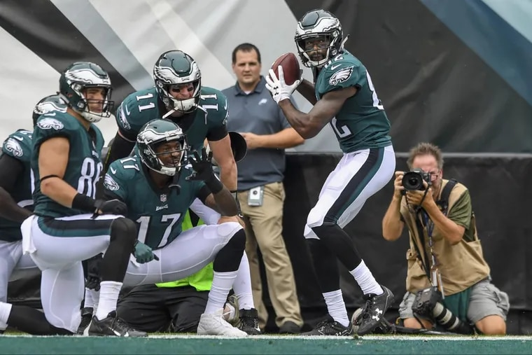 Eagles receiver Torrey Smith (holding ball) starts a baseball-themed group celebration after scoring against the Arizona Cardinals.