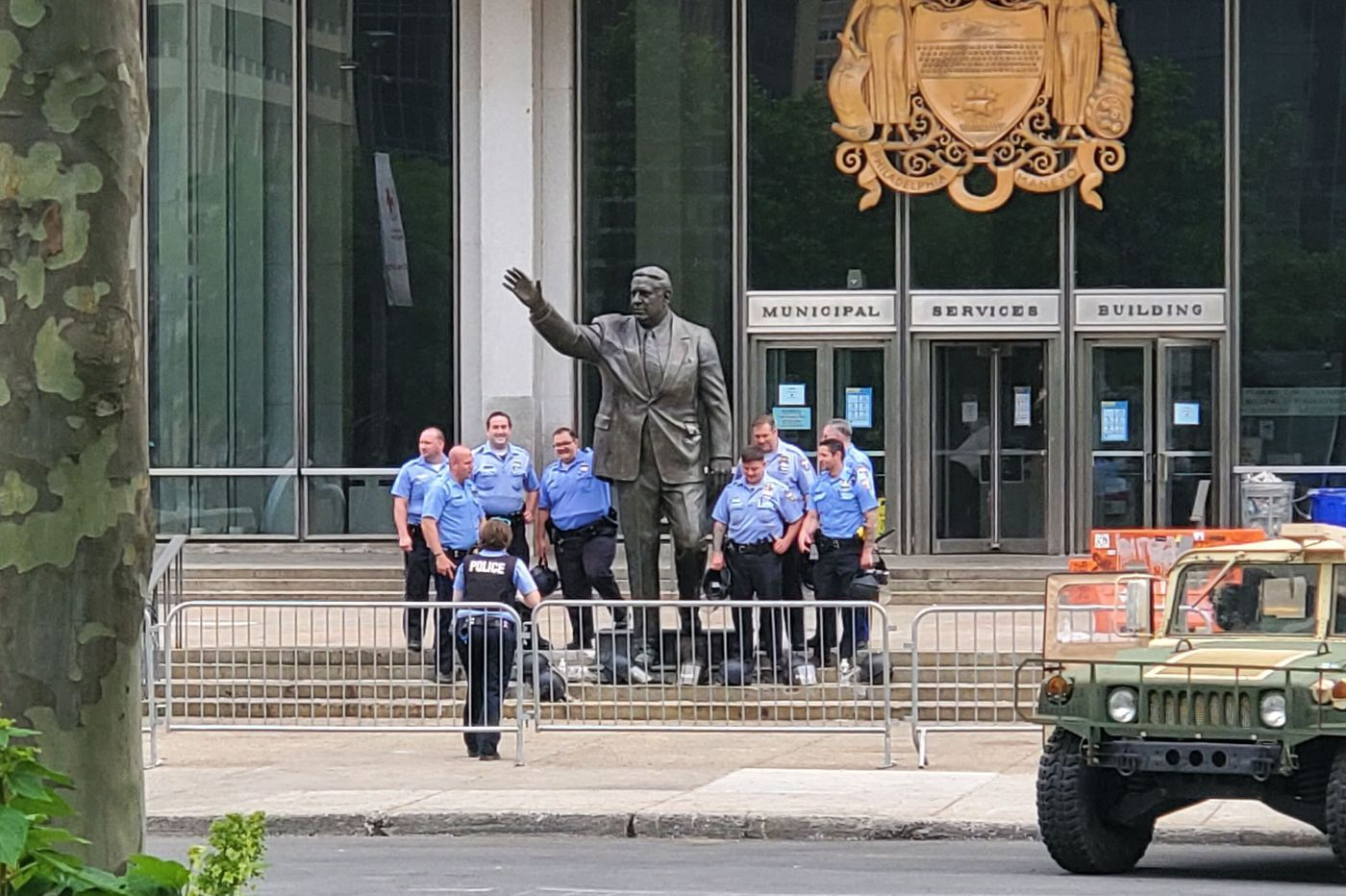 Philadelphia police officers appear to pose for picture at Rizzo statue days after protesters targeted it