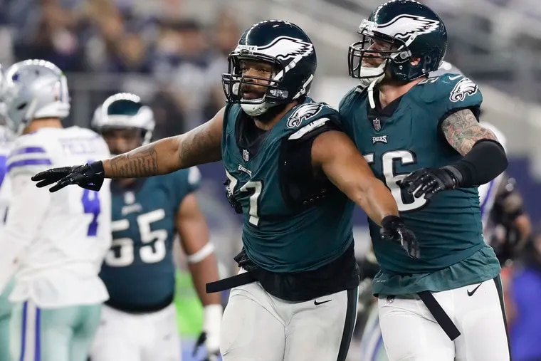 Eagles defensive end Michael Bennett and defensive end Chris Long celebrate a stop against the Dallas Cowboys on Sunday, December 9, 2018 in Arlington, TX.  Bennett stripped the football from Dallas Cowboys quarterback Dak Prescott on the play.  YONG KIM / Staff Photographer