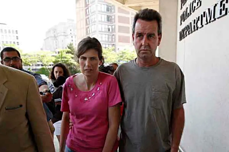 Catherine and Herbert Schaible, at right, were charged with third-degree murder, involuntary manslaughter and other charges in the death of another son, Brandon, in April. They are seen here turning themselves in at Philadelphia police headquarters in Philadelphia on May 22, 2013.  ( DAVID MAIALETTI / Staff Photographer )