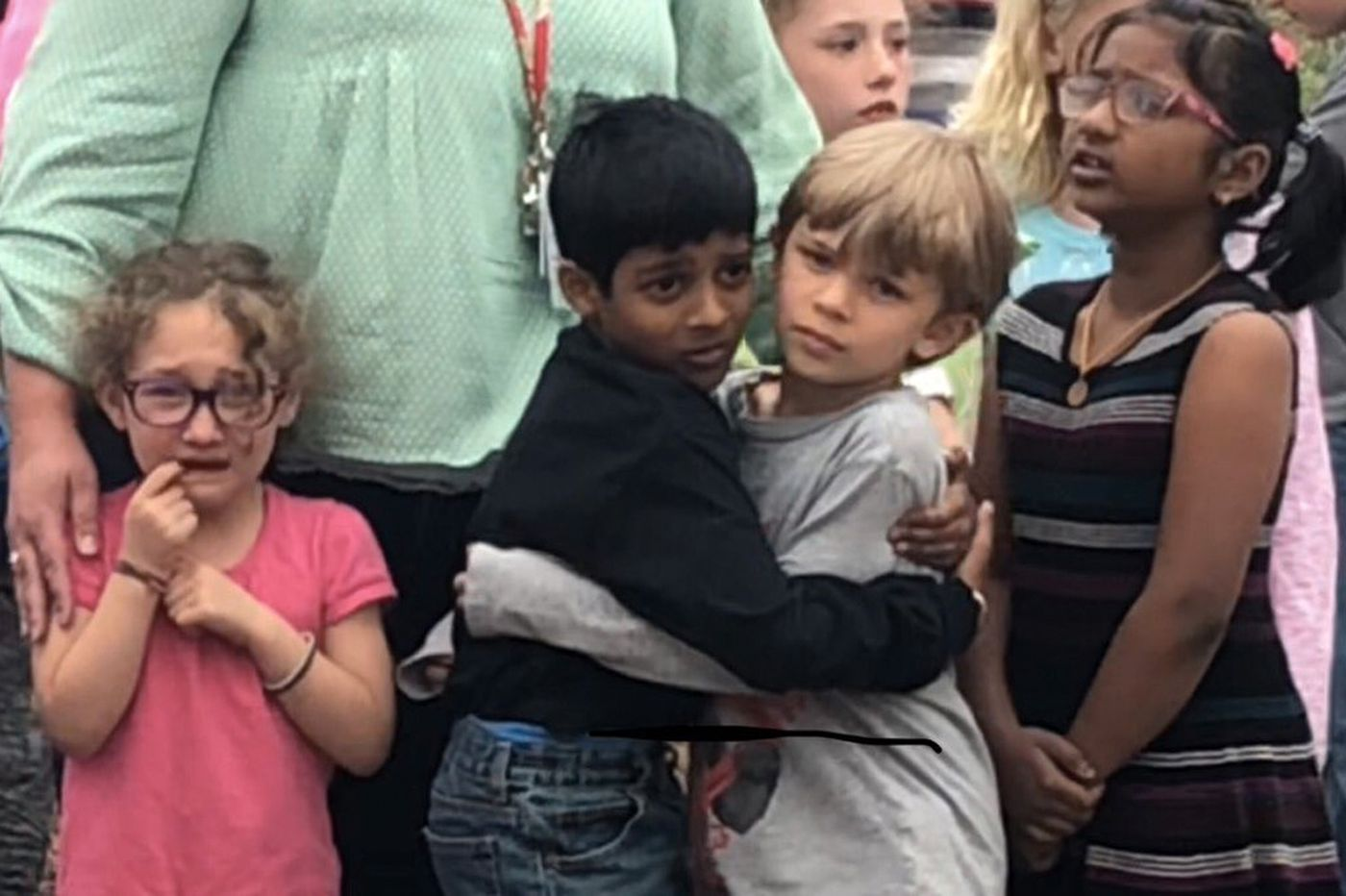 Viral image from Colorado school shooting shows young students embracing following deadly attack