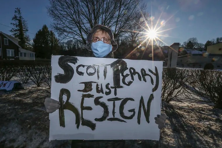 Pamela Hunter, of Cumberland County, protests Rep. Scott Perry near Perry's office in Wormleysburg on Friday.