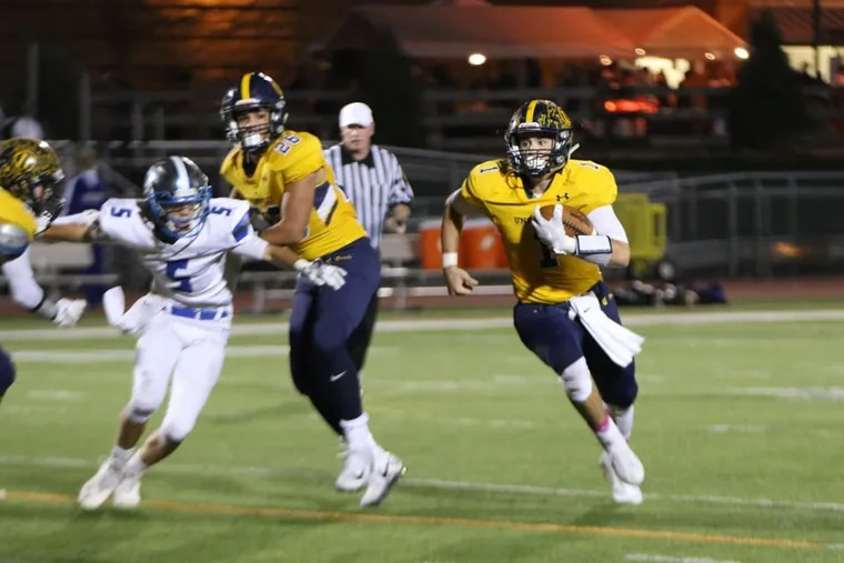 Unionville's Joe Zubillaga (1) looks for running room in a 41-14 win over Ches-Mont League American Division rival Great Valley.