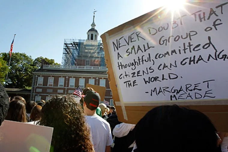 A quote from Margaret Mead, about making a difference, on a sign outside Independence Hall sums up the hopes driving the Occupy Philadelphia rally. The marchers covered eight blocks from City Hall to the historic area. (Alex Branson / Associated Press)