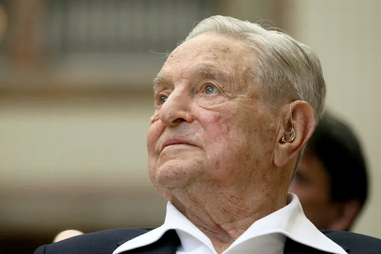 In this June 21, 2019 photo, George Soros, founder and chairman of the Open Society Foundations, looks on before the Joseph A. Schumpeter award ceremony in Vienna, Austria. Soros, the billionaire investor and philanthropist, has long been a target of conspiracy theories.