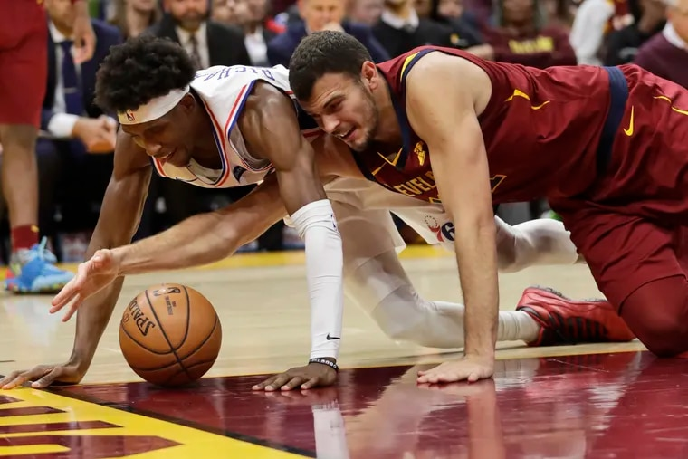 Josh Richardson (left) and Cleveland's Ante Zizic battle for the ball during the second half of Sunday's game.