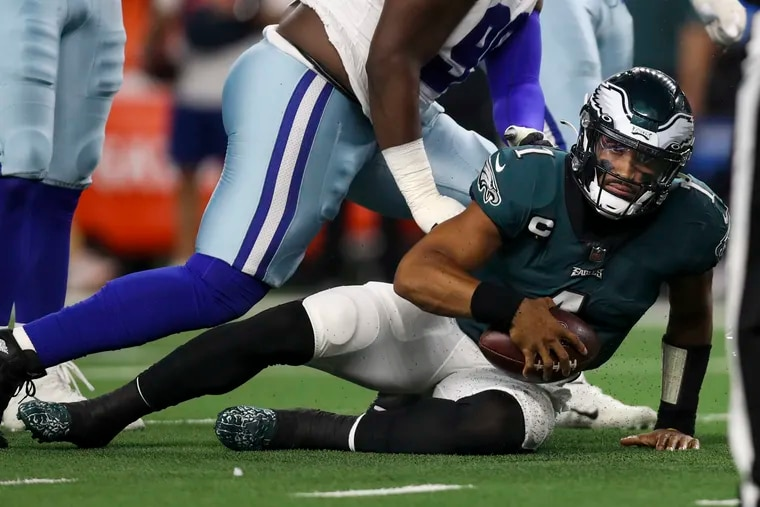 Philadelphia Eagles quarterback Jalen Hurts (1) on the ground after getting sacked during the Philadelphia Eagles game against the Dallas Cowboys at AT&T Stadium in Arlington, Texas on Monday, September 27, 2021.