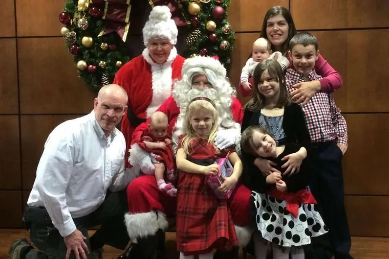 The Kochanowicz family, clockwise from top, Michelle (holding Andrew), Nicholas, Isabella, Amelia, Alyssa, Lily, and Mark.