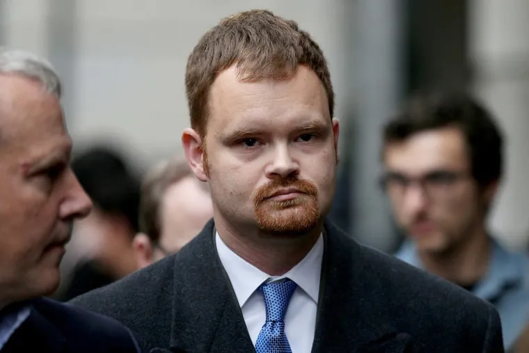Former Amtrak engineer Brandon Bostian walks out of the Criminal Justice Center on Wednesday, Dec. 20, 2017. Prosecutors' attempt to reinstate charges against him for the 2015 train derailment that killed eight people.