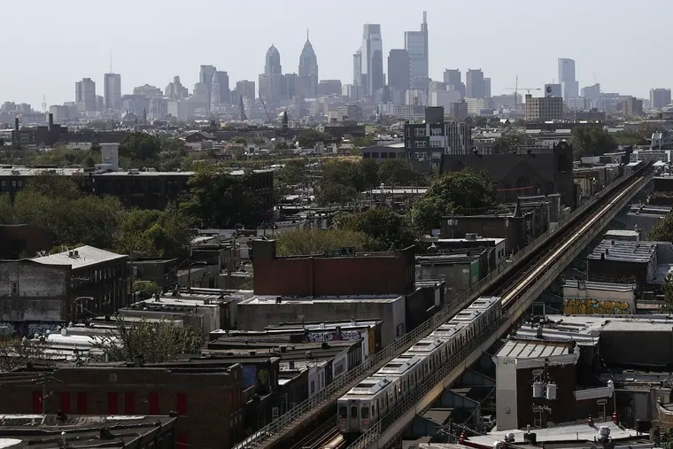 The Philadelphia skyline is seen behind an eastbound SEPTA train on the Market-Frankford line in the Kensington neighborhood of Philadelphia on Tuesday, Oct. 01, 2019.