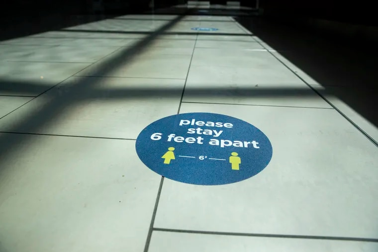 Social distancing decals on the floor in PREIT's Cherry Hill Mall in Cherry Hill, N.J.