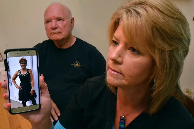 Heidi Austin, with her father, Josef Wituschek, displays a photo of guardian Gloria Byars from Byars' Facebook page during an interview last year in Wituschek's home in the Fox Chase section of Philadelphia.