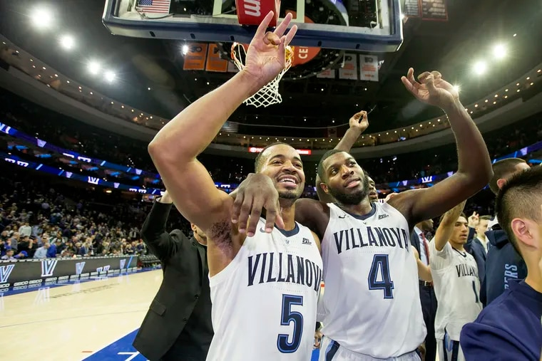Villanova's Phil Booth, left, and Eric Paschall are scheduled to workout for the Sixers on Saturday.