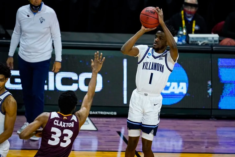 Villanova guard Bryan Antoine shoots over Winthrop forward Chase Claxton in an NCAA Tournament game in March.