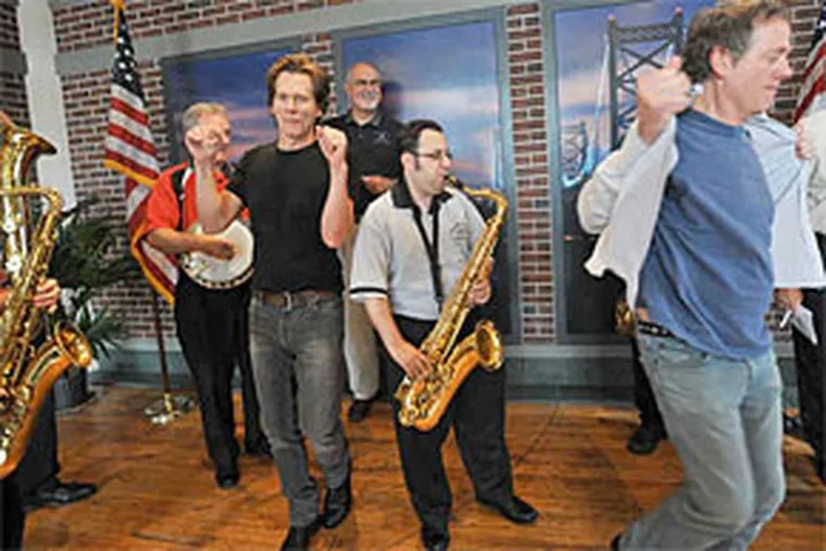Ready for Two Street? Carmen Vitanza of Greater Overbrook plays sax, while the Bacon Brothers - Kevin (left) and Michael - strut. (Sharon Gekoski-Kimmel / Staff Photographer)