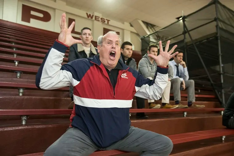 """Mike Arizin, a son of late Philly basketball great """"Pitchin' Paul"""" Arizin, channels his dad's passion during games at St. Joe's Prep, where his own son and nephew play hoops."""