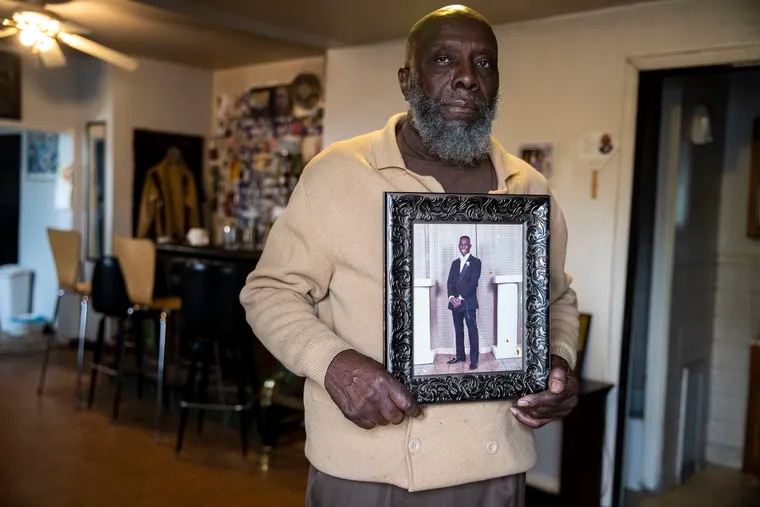 Ralph Brown holds a prom photo of his son Darren Brown, who was fatally shot in June 1990 by Derrick Ragan, who had killed another person 11 days earlier.