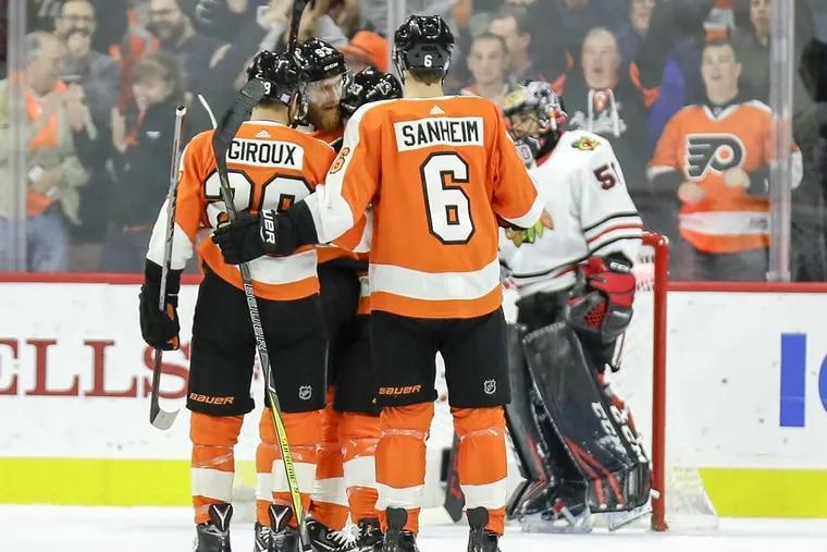 Flyers right wing Jakub Voracek celebrates his first-period goal with teammates center Claude Giroux, defenseman Shayne Gostisbehere and defenseman Travis Sanheim against Blackhawks on Thursday.