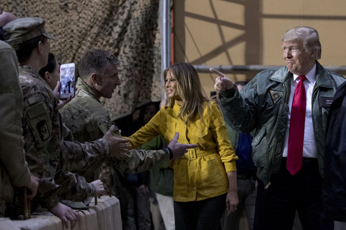 U.S. forces will stay in Iraq, could reenter Syria from there, Trump says