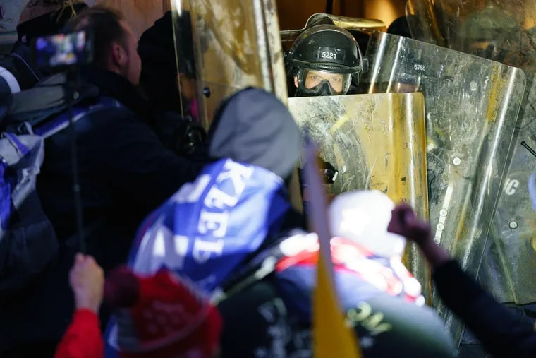 Rioters clash with police to try and gain entrance to a door at the Capital, Jan. 6, 2021 in Washington, DC. The United States Capitol Building was breached by Pro-Trump supporters.
