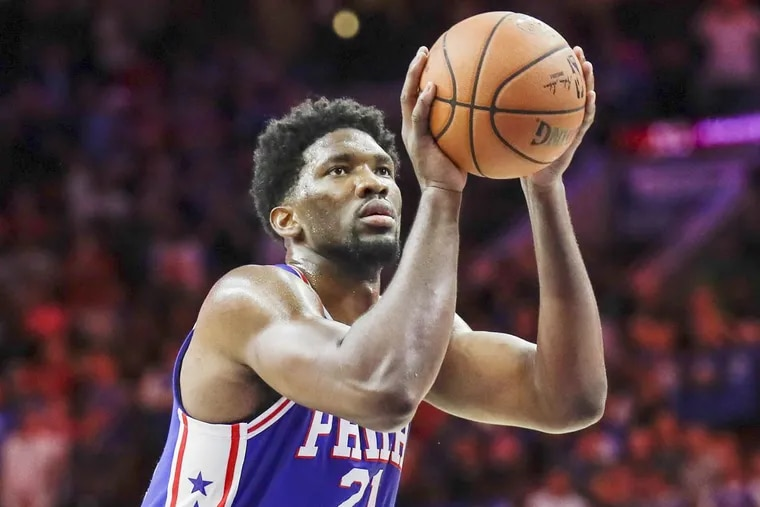 Sixers center Joel Embiid shoots a free throw against the Pacers on Nov. 3.