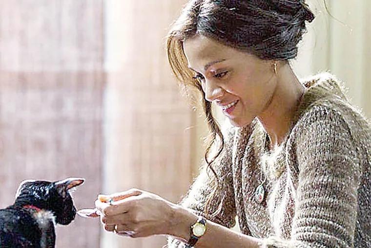 """ROSEMARY'S BABY -- Pictured: Zoe Saldana as Rosemary -- Zoe Saldana (with cat) stars in the NBC miniseries """"Rosemary's Baby"""" (Roger Do Minh/NBC)"""