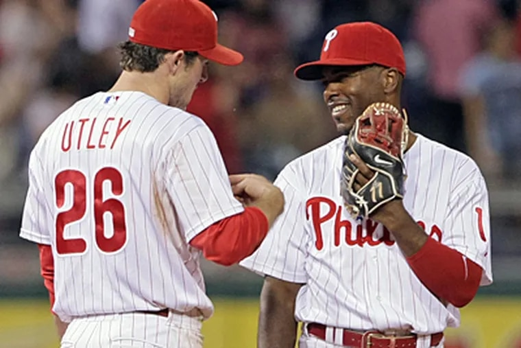 Chase Utley and Jimmy Rollins share a laugh in the field. With 21 home runs, Utley leads the major leagues. (Jerry Lodriguss/Inquirer)