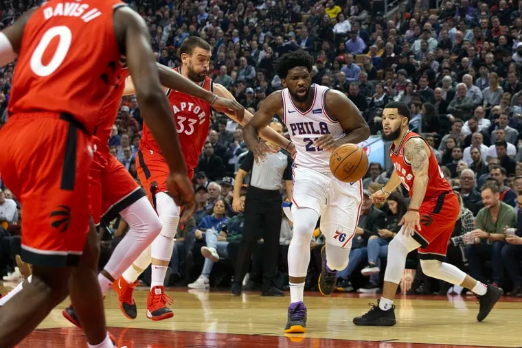 Joel Embiid had a tough time against Marc Gasol (33) and the Raptors on Monday.
