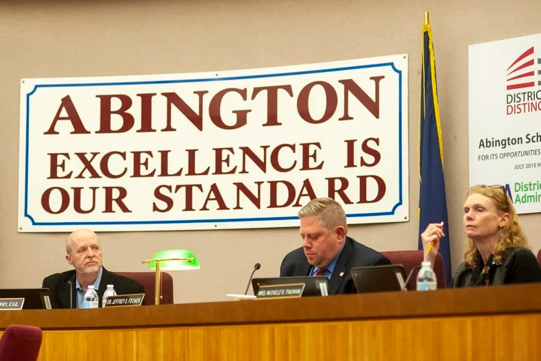 Board President Raymond McGarry (left) makes remarks before voting on a new member for the Abington school board Nov. 26. WILLIAM THOMAS CAIN / For The Inquirer