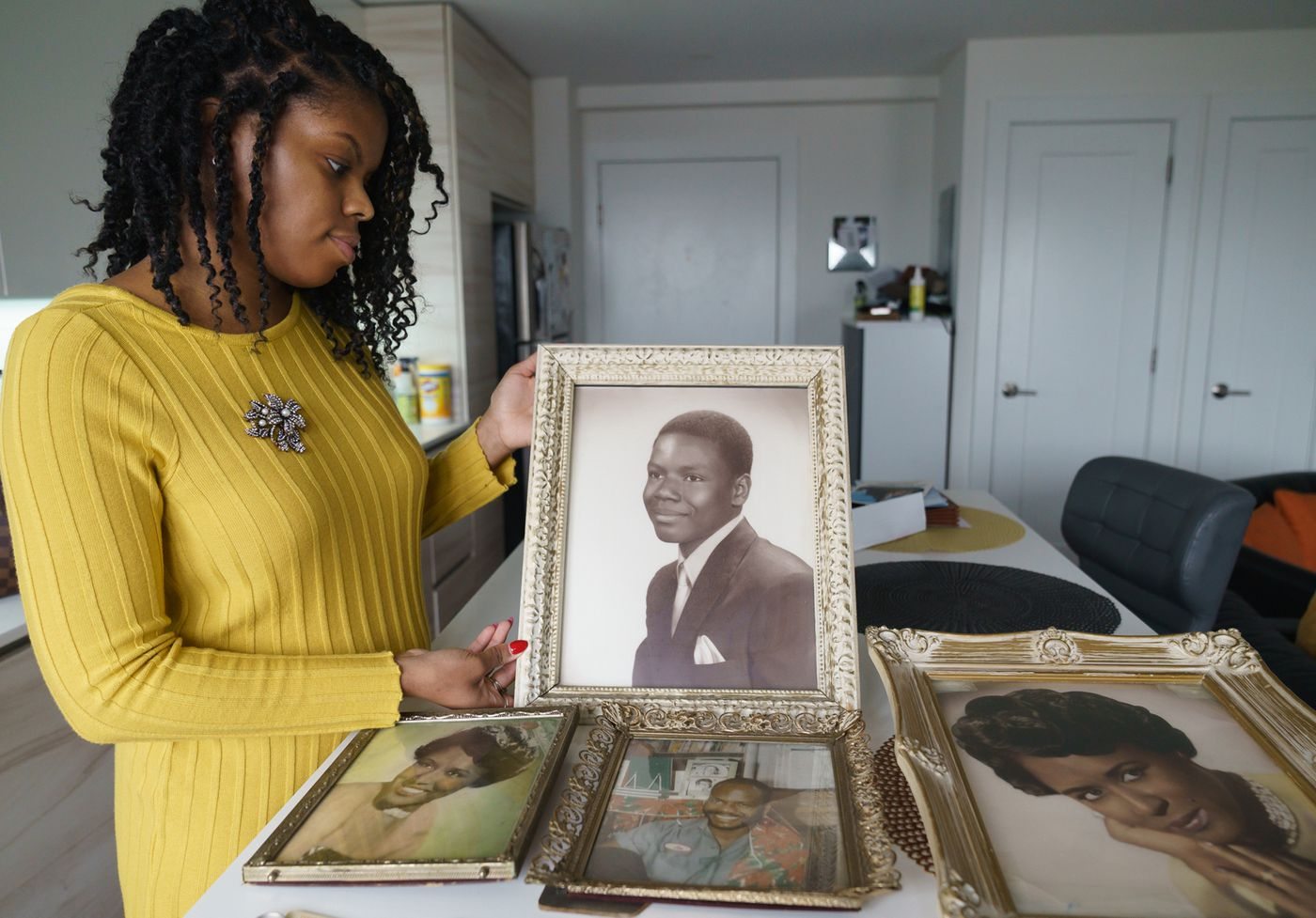 Vaneeda Days, the great-niece of Dorothy Beam, holds a photograph of Joseph Beam, who was a trailblazing black gay author from Philadelphia.