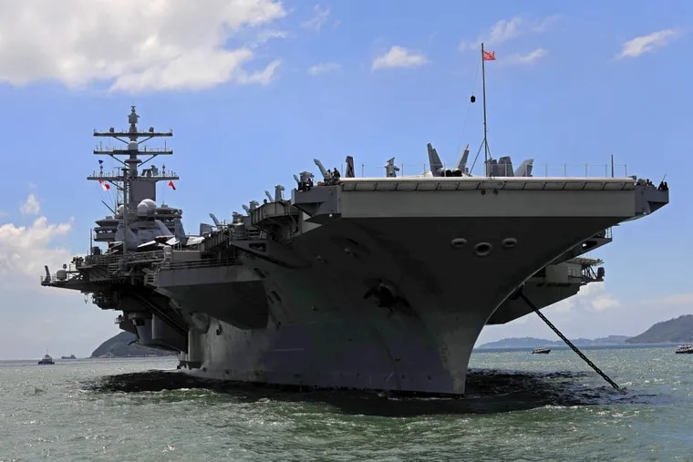 """The USS Ronald Reagan arrives in Hong Kong last month. """"We have too many planes that can't fly and ships that can't sail and a military that is too small to adequately face the numerous, diverse, and dangerous threats to our national security,"""" says Christopher Lehman."""