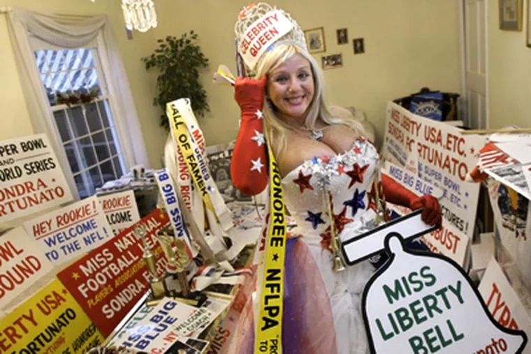 """A Miss Liberty Bell title, one of many commemorated in her living room, gives Sondra Fortunato a head start if she decides to anoint Philadelphia's NFL franchise as the one she will support. """"I'm not flaunting myself just for myself,"""" she says. (Elizabeth Robertson / Staff Photographer)"""