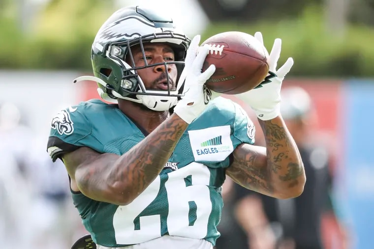 Eagles running back Miles Sanders catches the ball during a drill at training camp.