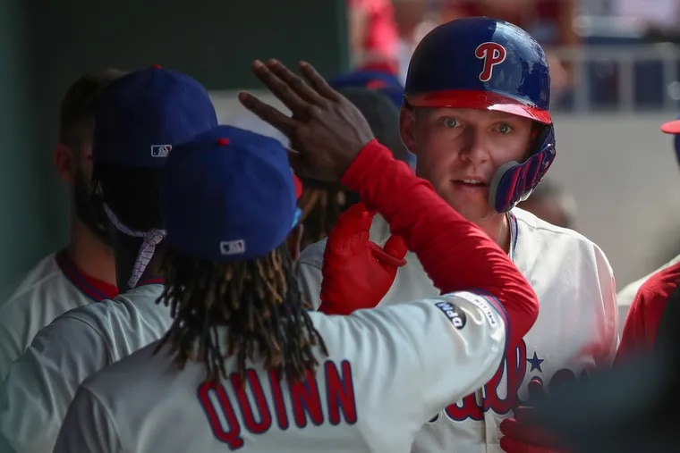 Phillies first baseman Rhys Hoskins, shown here in the dugout last month, was not in Friday night's lineup.